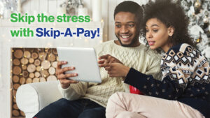 Skip Your Next Loan Payment Ad with Couple looking phone