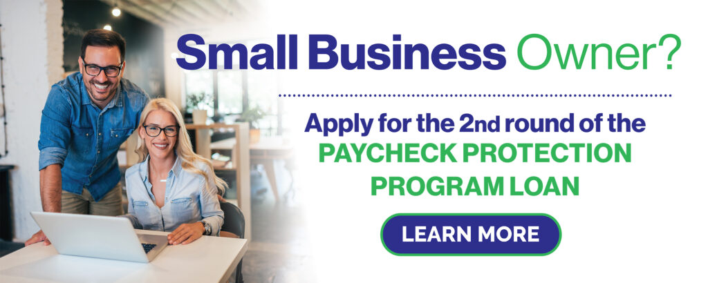 CPCU Small Business Owner Apply for PPP Loan With Man and Woman Smiling at a Table with Laptop